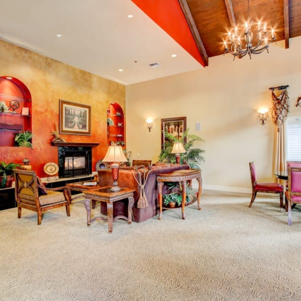 Clubhouse front entrance with comfortable seating and a fireplace at The Dakota Apartments in Lacey, Washington