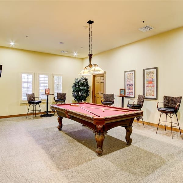 Billiards room with chairs and tables at Laguna Creek Apartments in Elk Grove, California