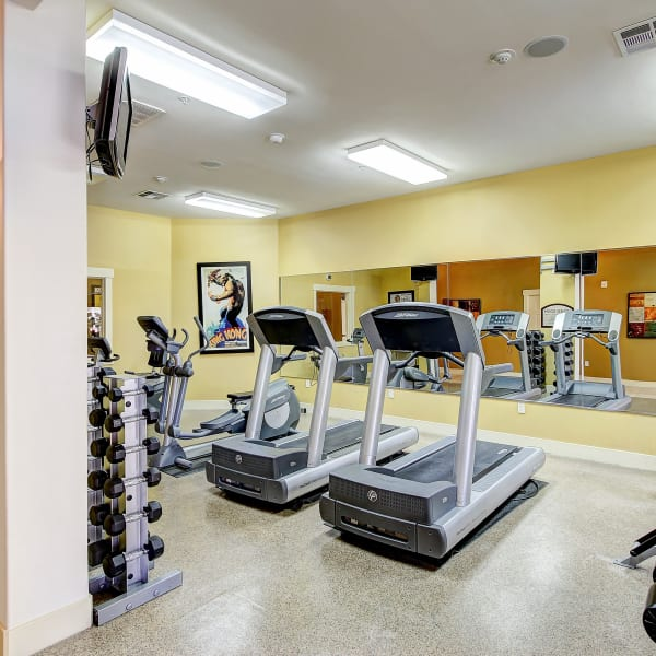 Fitness center with individual workout stations at Monticello at Southport in West Sacramento, California