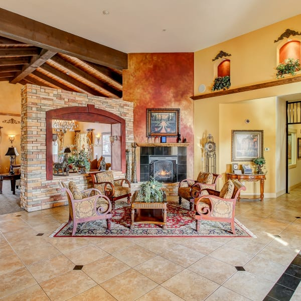 Clubhouse entrance with comfortable seating and a fireplace at Monticello at Southport in West Sacramento, California
