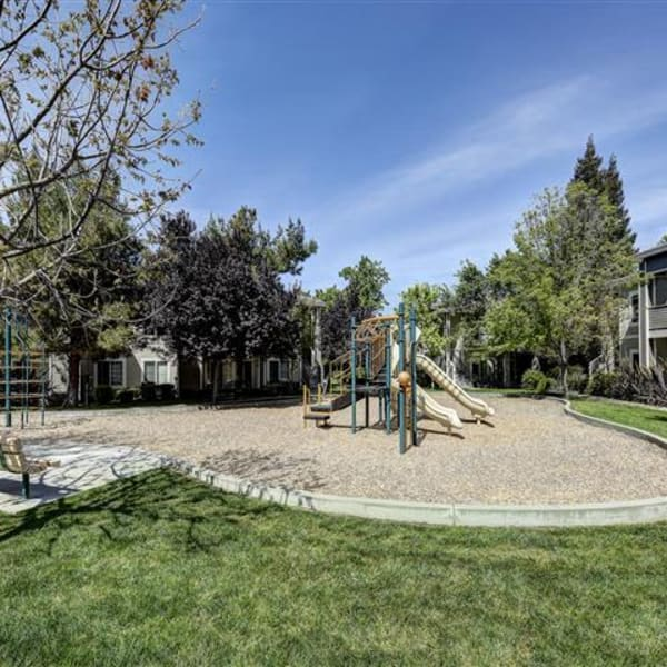 Children's playground surrounded by grass at Monticello at Southport in West Sacramento, California
