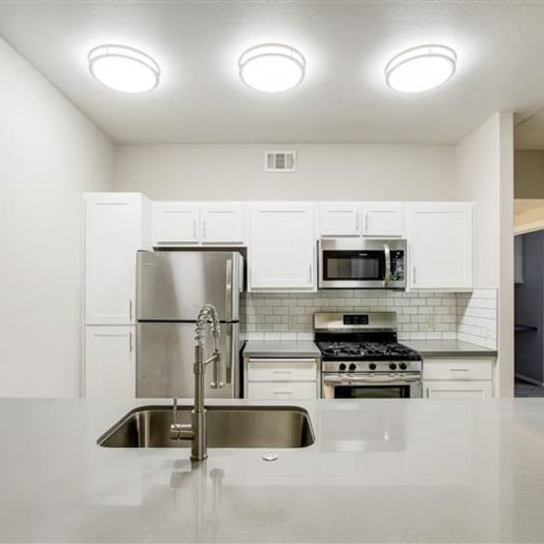 Kitchen with stainless-steel appliances at Monticello at Southport in West Sacramento, California