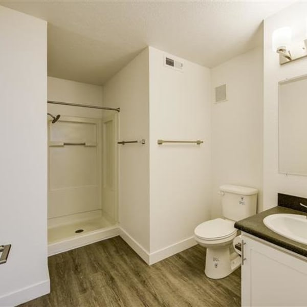 Spacious bathroom with large vanity mirror at Northwind Apartments in Reno, Nevada