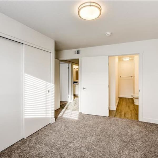 Master bedroom with plush carpeting at Northwind Apartments in Reno, Nevada
