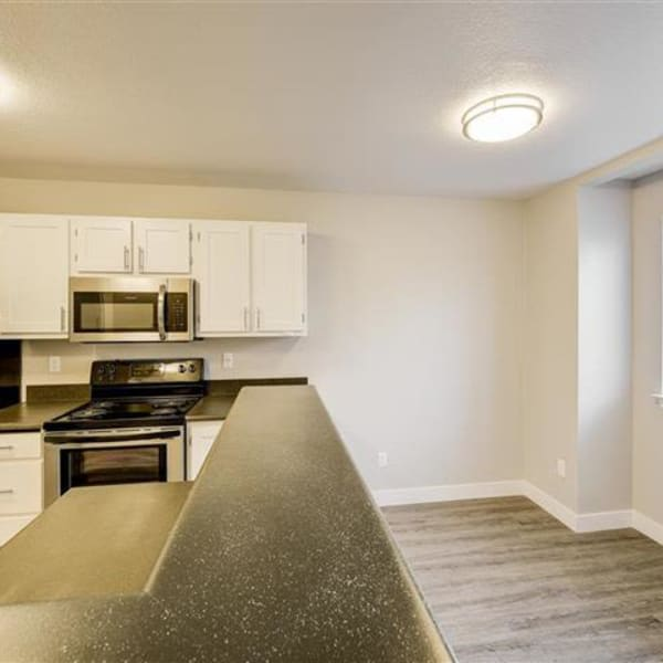 Dining room with wood-style flooring a window for natural lighting at Northwind Apartments in Reno, Nevada