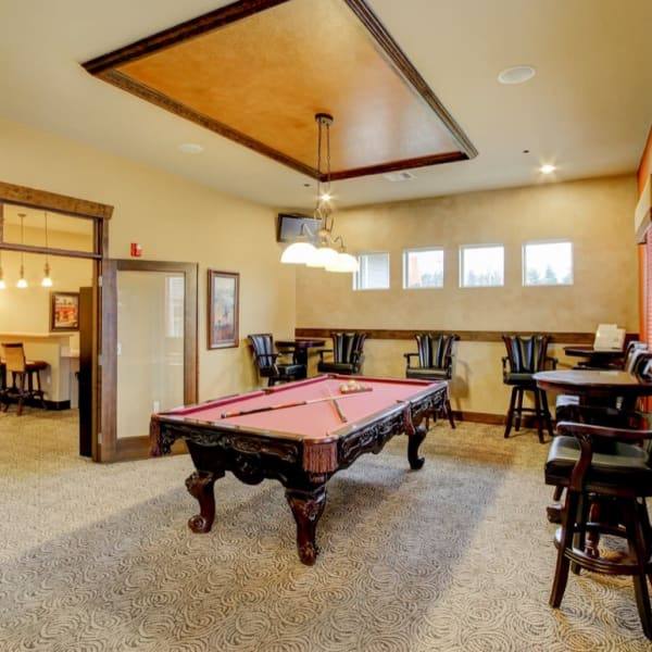 Billiards room with plenty of seating at The Meadows in Tacoma, Washington