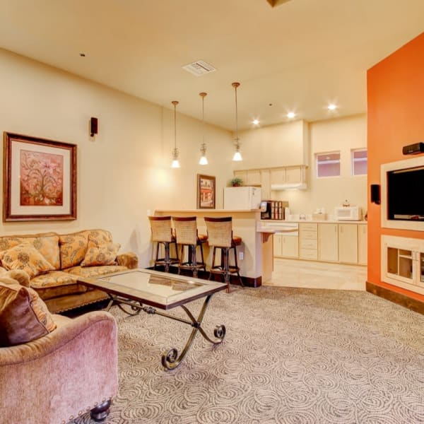 Community lounge with a kitchen and flat-screen tv at The Meadows in Tacoma, Washington