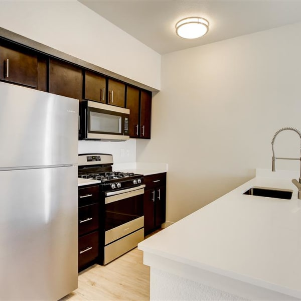 Spacious kitchen with microwave at The Palms at Morada in Stockton, California
