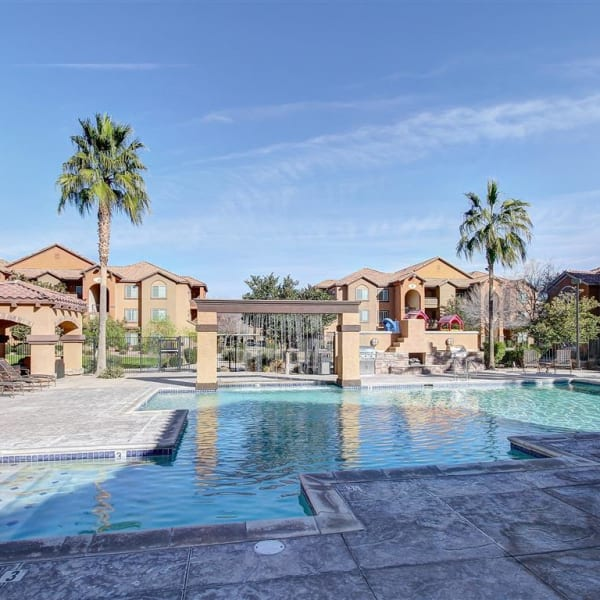 Resort-style swimming pool with a large sundeck at Tierra Pointe in Casa Grande, Arizona