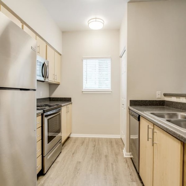 The Dakota Apartments in Lacey, Washington offers a kitchen with appliances