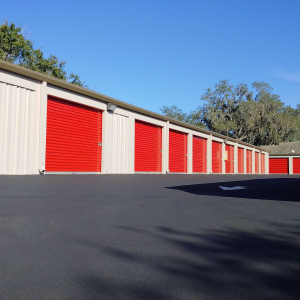 Outdoor storage units with bright doors at StorQuest Self Storage in Clearwater, Florida