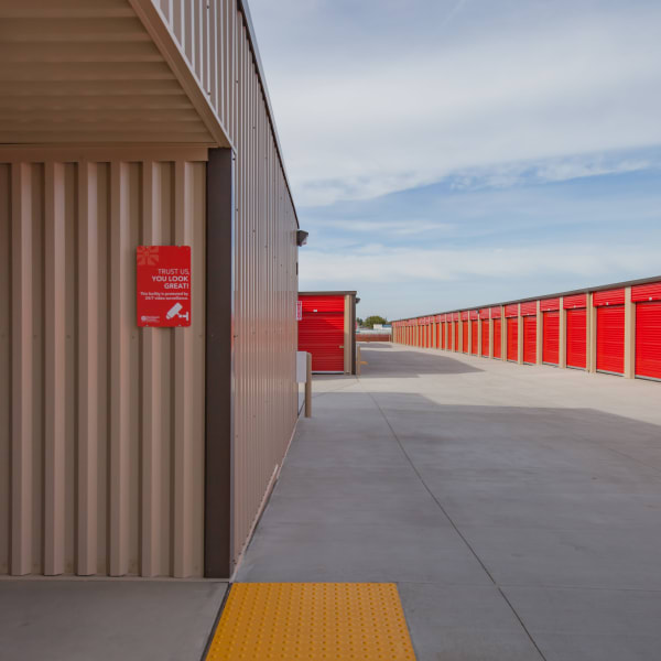 Outdoor storage units with bright doors at StorQuest Express - Self Service Storage in Sacramento, California