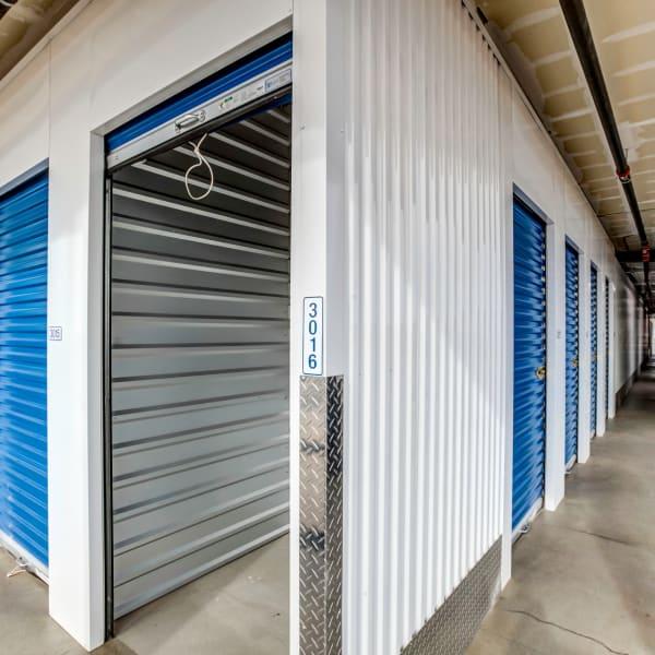 Blue doors on indoor units at StorQuest Self Storage in Buckeye, Arizona