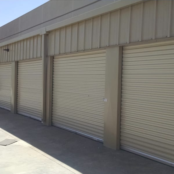Outdoor storage units with beige doors at StorQuest Self Storage in Richmond, California