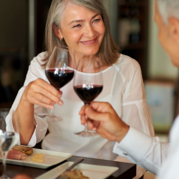 Resident couple toasting over wine at Quail Park at Morrison Ranch in Gilbert, Arizona