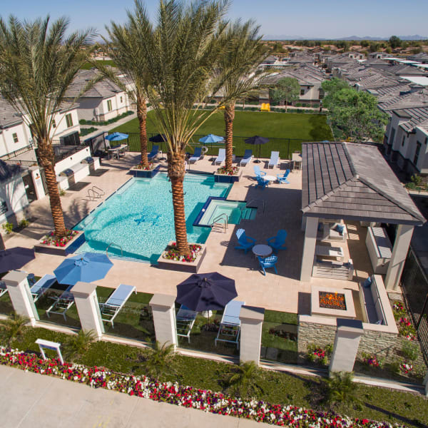 Couple enjoy the sundeck at the pool at Christopher Todd Communities on Mountain View in Surprise, Arizona