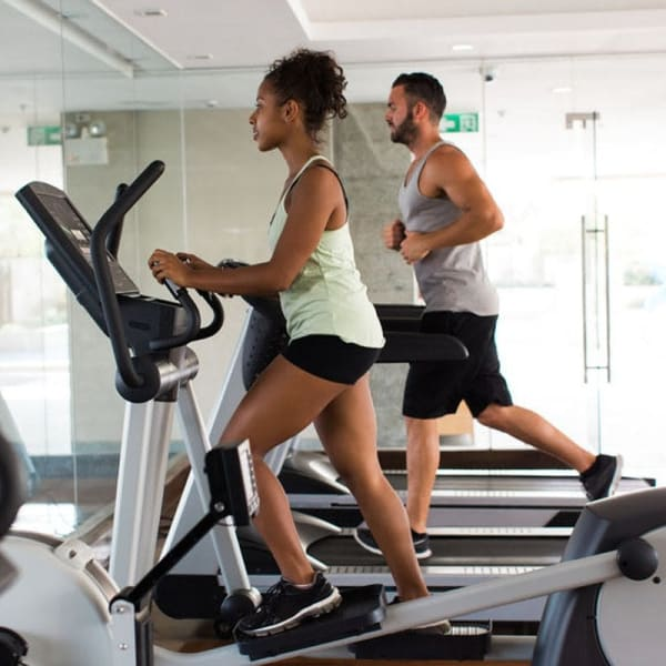 Residents staying in shape in the fitness center at Cadia Crossing in Gilbert, Arizona