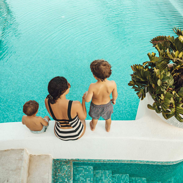 Mother and two sons about to take a dip in the pool at Legends at White Oak in Ooltewah, Tennessee