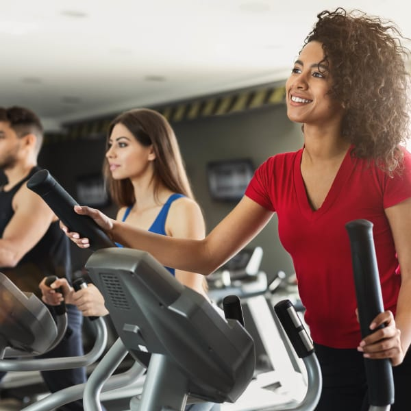 Residents staying in shape in the fitness center at Mosaic Dallas in Dallas, Texas