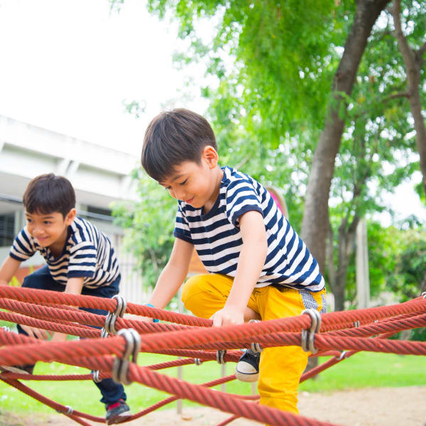 Children playing at the onsite playground at Olympus Katy Ranch in Katy, Texas