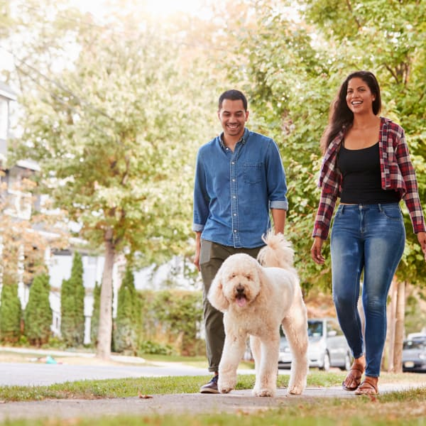 Residents taking their dog for a stroll through the neighborhood at Olympus Solaire in Albuquerque, New Mexico