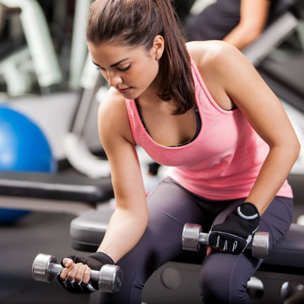 Resident staying in shape in the fitness center at Olympus Waterford in Keller, Texas