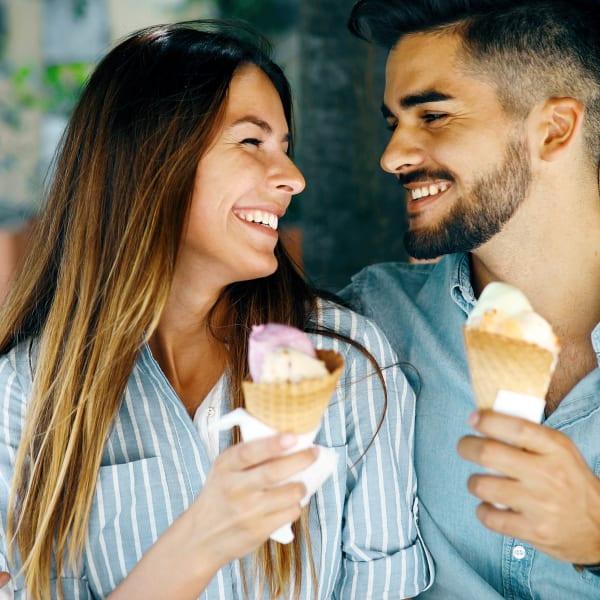 Resident couple enjoying ice cream downtown near Redstone at SanTan Village in Gilbert, Arizona