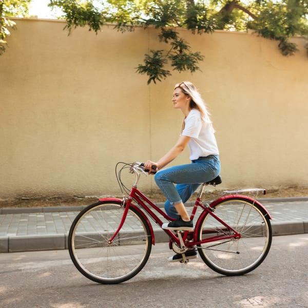 Resident riding her bike through the neighborhood at Redstone at SanTan Village in Gilbert, Arizona