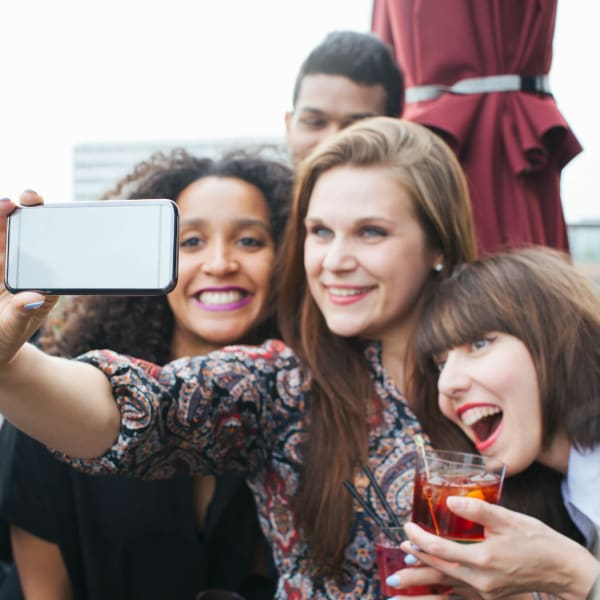 Residents posing for a group selfie at Tacara at Westover Hills in San Antonio, Texas