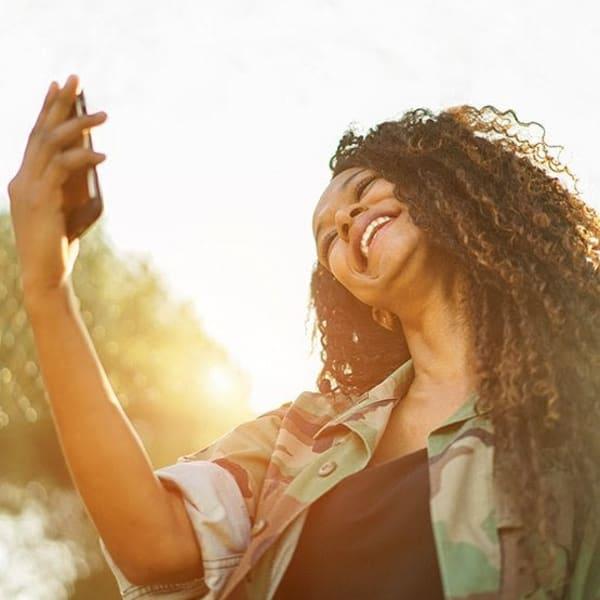 Resident taking a selfie outside at Vistara at SanTan Village in Gilbert, Arizona