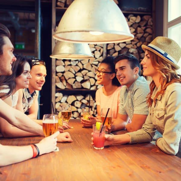 Residents enjoying drinks at their favorite bar near Walden at Chatham Center in Savannah, Georgia