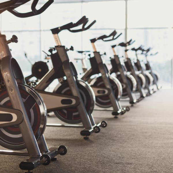 Exercise bikes in the fitness center at Olympus on Broadway in Carrollton, Texas
