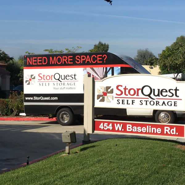 Signage and a moving truck at StorQuest Self Storage in Claremont, California