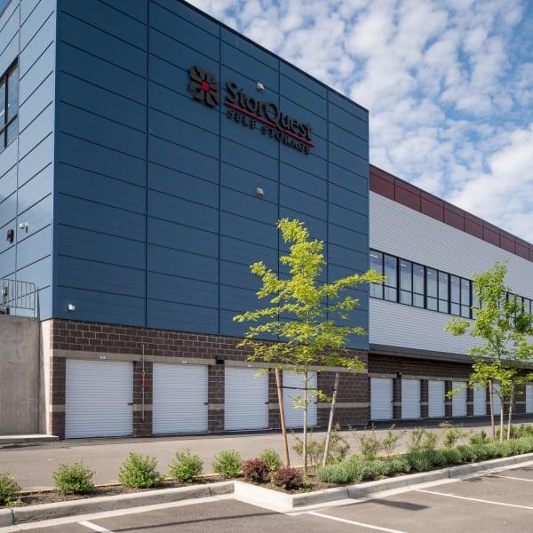 Outdoor storage units with white doors at StorQuest Self Storage in Redmond, Washington
