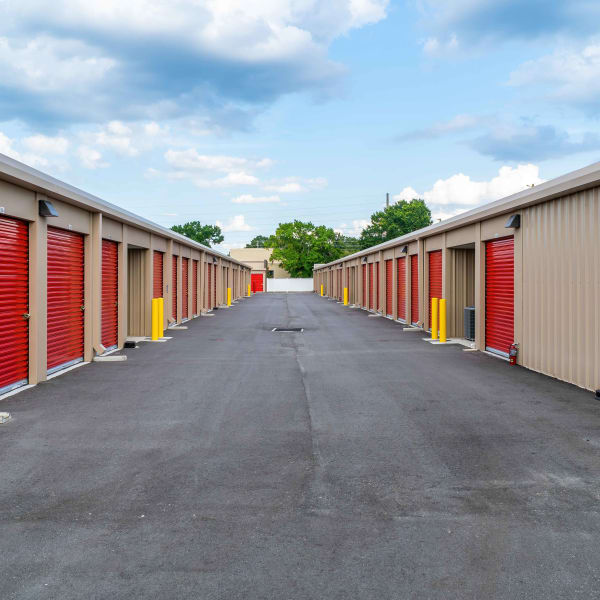 Outdoor storage units with bright doors at StorQuest Express - Self Service Storage in Kissimmee, Florida