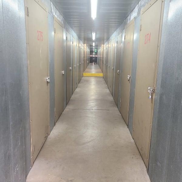 Indoor units with locked doors at StorQuest Self Storage in Arvada, Colorado