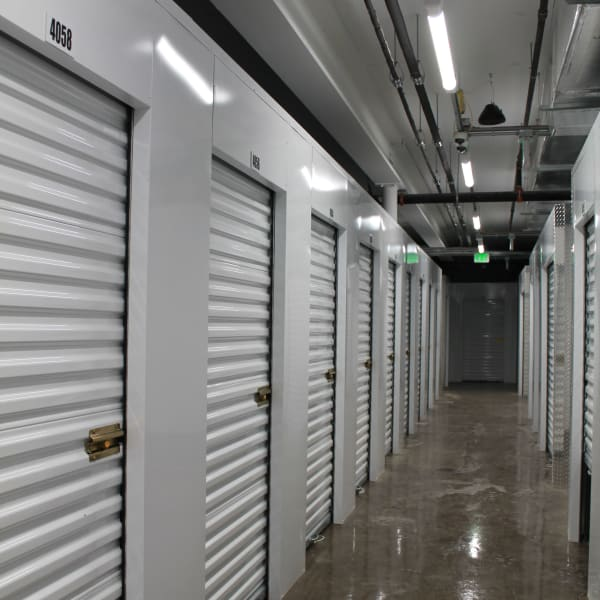 Indoor storage units with white doors at StorQuest Self Storage in Honolulu, Hawaii