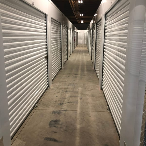 Outdoor storage units with white doors at StorQuest Express - Self Service Storage in Sonora, California