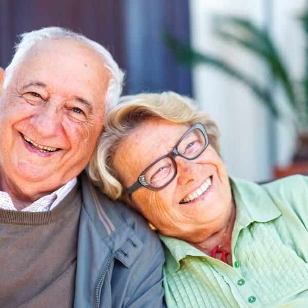 Senior Couple Sitting outside at Deephaven Woods in Deephaven, Minnesota