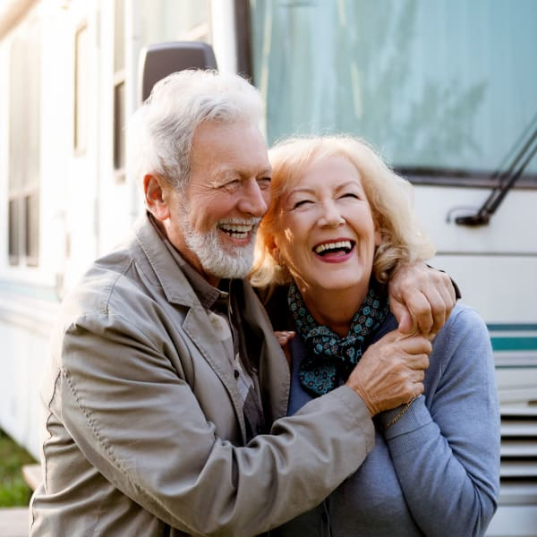 Couple preparing their RV for parking at StayLock Storage in Panama City, Florida
