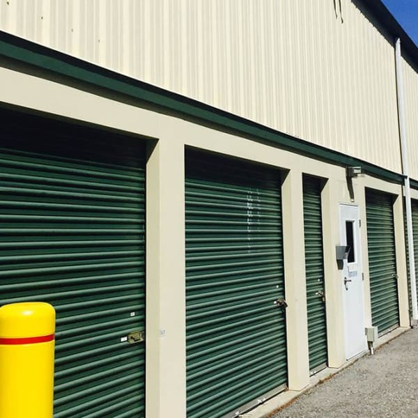 Outdoor storage units with bright doors at StorQuest Express - Self Service Storage in Briarcliff Manor, New York