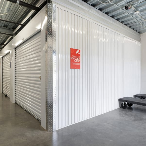 Moving carts next to climate-controlled units at StorQuest Self Storage in Vista, California
