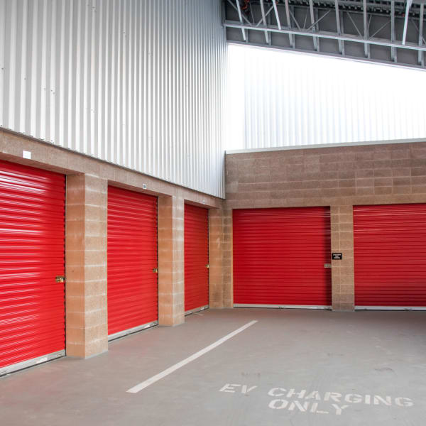 Indoor storage units with bright doors at StorQuest Self Storage in Los Angeles, California