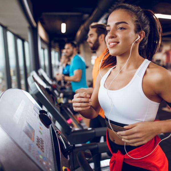 Residents running on a treadmill at Palmetto Greens Apartment Homes in Covington, Louisiana