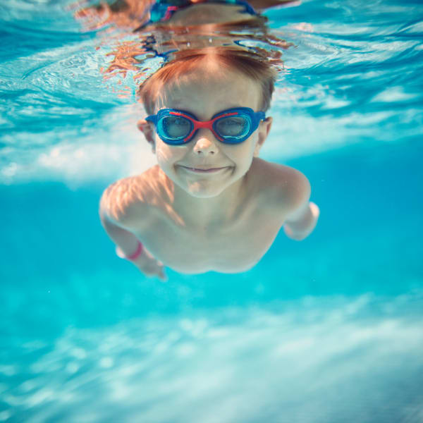 Child swimming in the pool at North Shore Apartment Homes in Slidell, Louisiana