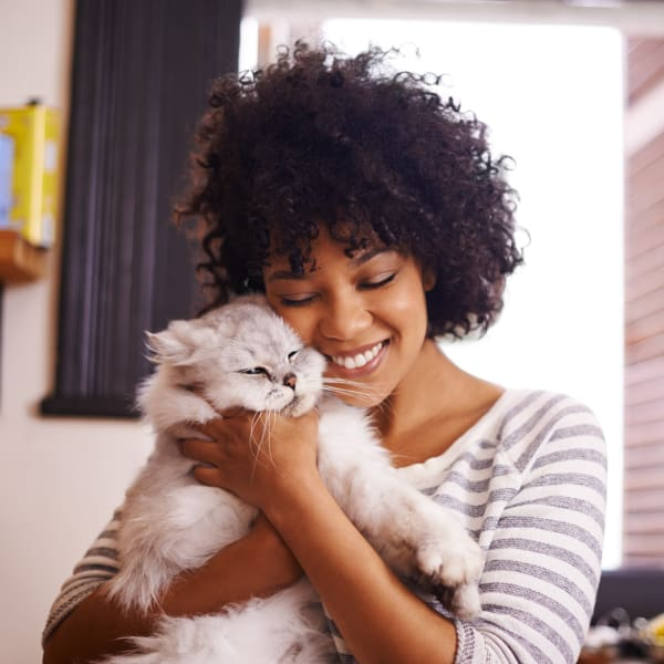 Resident hugging her cat at North Shore Apartment Homes in Slidell, Louisiana