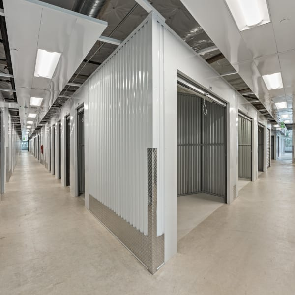 Climate controlled indoor storage units with opened doors at StorQuest Self Storage in Los Angeles, California