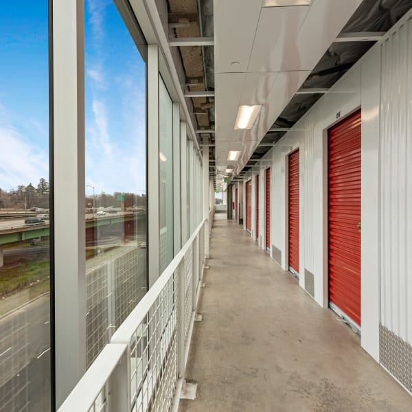 Red doors on small indoor units at StorQuest Self Storage in Los Angeles, California
