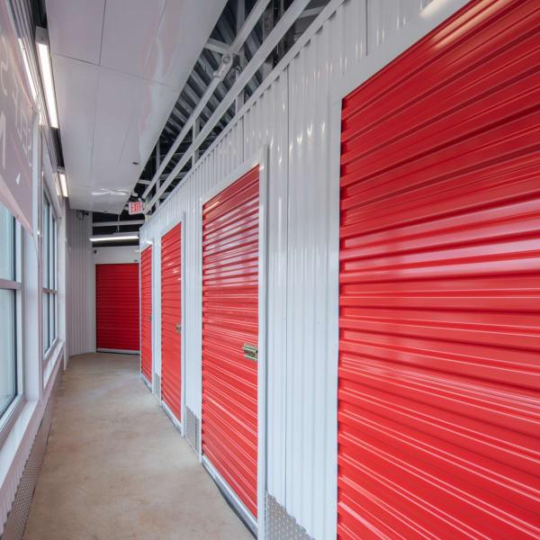 Red doors on indoor units at StorQuest Self Storage in Tigard, Oregon