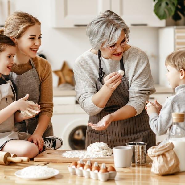 Family baking together at Ocio Plaza Del Rio in Peoria, Arizona